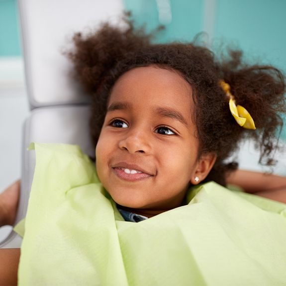 Little girl smiling after fluoride treatment