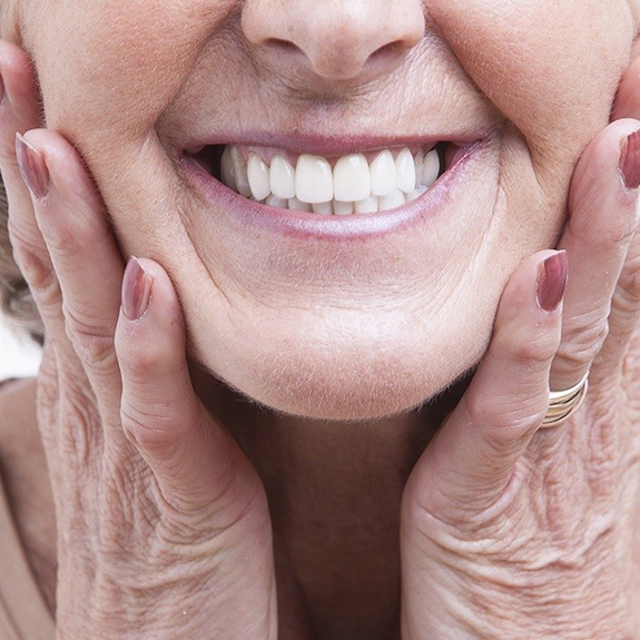 Woman showing off a full denture