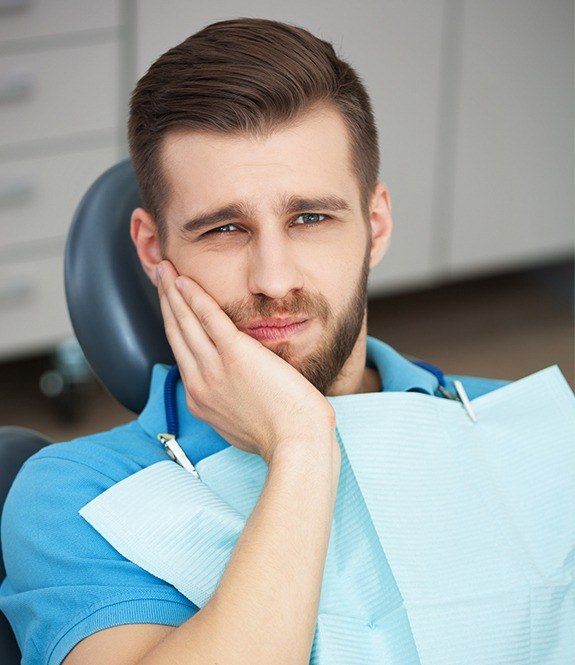Man with toothache at dental office for tooth extraction