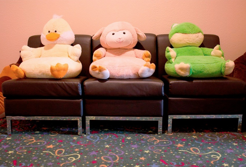 Stuffed animal toys on waiting room chairs
