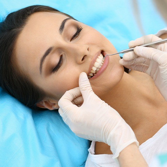 Woman smiling during periodontal maintenance visit