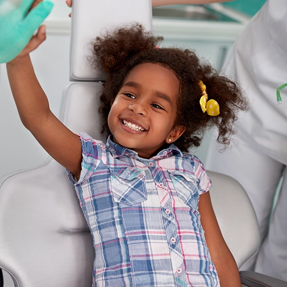 Smiling child at dental office relaxed with oral conscious sedation dentistry