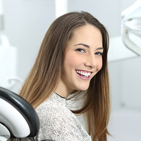 Woman with tooth-colored filling smiling at dentist office